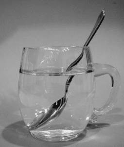 refraction of a wave-a spoon in a glass of water